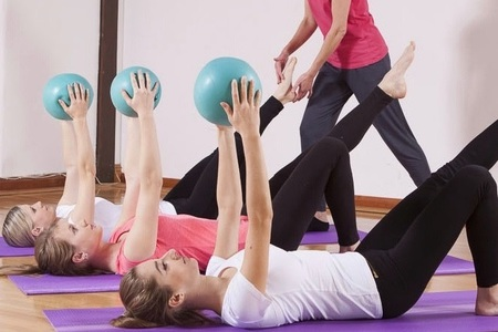 pilates class using the ball
